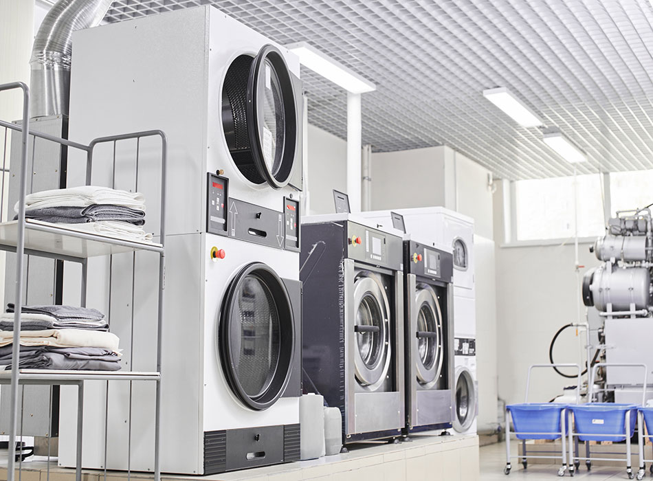Commercial washing machines in a hospitality setting