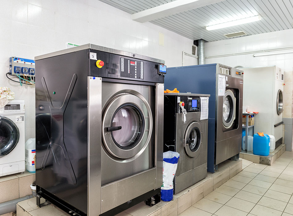 Commercial washing machines with dispensers set up